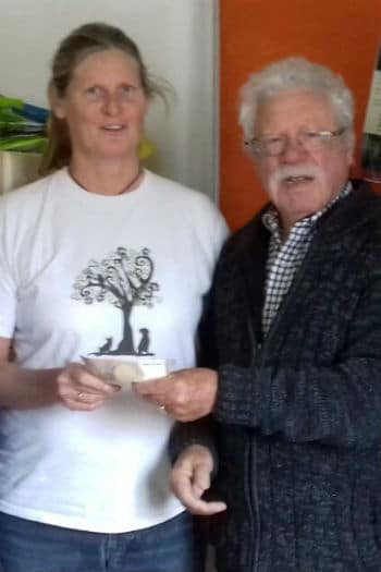 Linda Rane accepts donation from regular Valle Verde Animal Rescue supporter