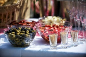 Table with olives in a bowl
